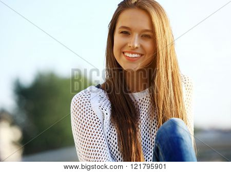 Portrait Of Young Smiling Beautiful Woman. Close-up portrait of a fresh and beautiful young fashion
