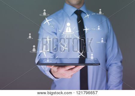 businessman holding a tablet pc. It shows planes. travel concept