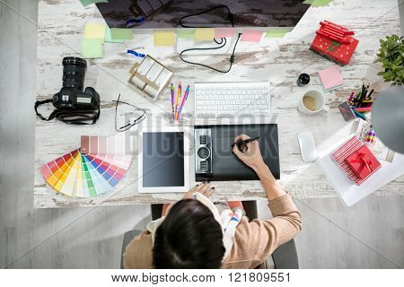 woman designer working on the pen table in office top view