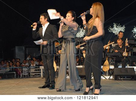 ANKARA/TURKEY-JUNE 8: Turkish Radio and Television (TRT)  folk music singers (from left) Ali Cakar, Emine Ata, Selma Gecer at the stage during the