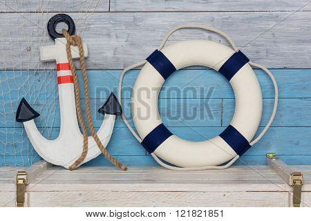 anchor and lifeline is on the background of aged wood