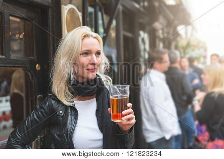 Beautiful Woman Enjoying A Pint Of Beer In London