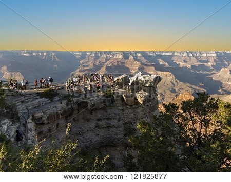 GRAND CANYON USA - JULY 8 2008: people enjoy the scenic view from mathers point to the Grand Canyon in sunset. The Grand Canyon is the most visited nature scenic spot in america.