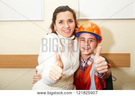 Young Contractor With Mother In Office. Ok