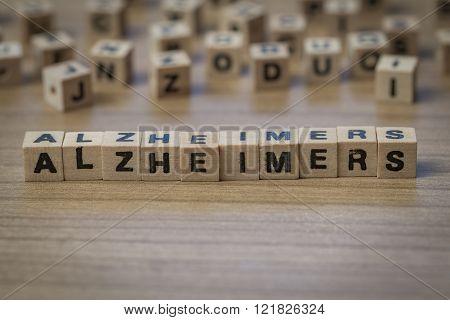 Alzheimer's written in wooden cubes on a table poster