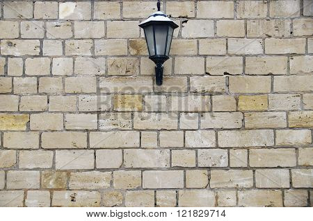 lantern on a brick wall background