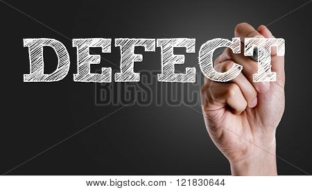 Hand writing the text: Defect