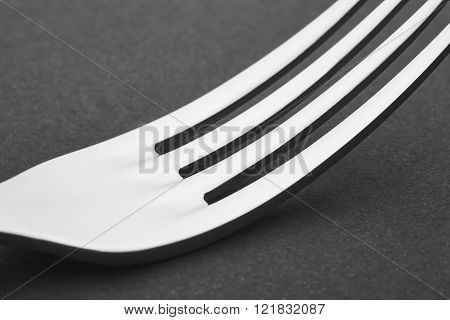 Fork Detail Over A Black Background. Cutlery