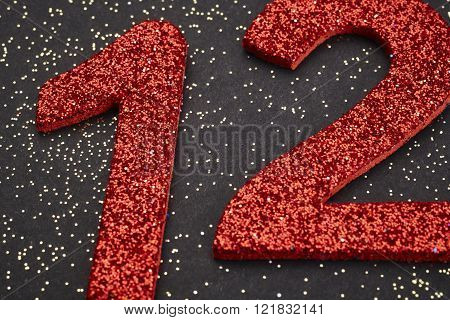 Number Twelve Red Color Over A Black Background. Anniversary