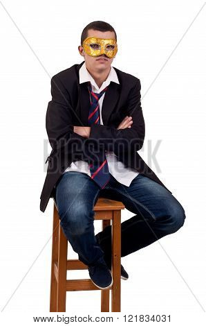 young man sitting on chair and wearing a Venetian mask