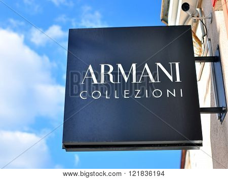 MINSK BELARUS - OCTOBER 4: Armani Collezioni logo on the flagship store in Minsk on October 4 2014. Armani Collezioni is a global world famous fashion brand founded in Italy.