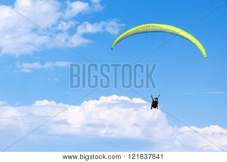 Paragliders In Bright Blue Sky With Clouds