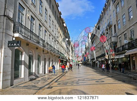 LISBON PORTUGAL - DECEMBER 19: Zara flagship store on Agusta street in Baixa district of Lisbon on December 19 2013. Lisbon is the largest city and capital of Portugal with a population of 547 000 citizens.
