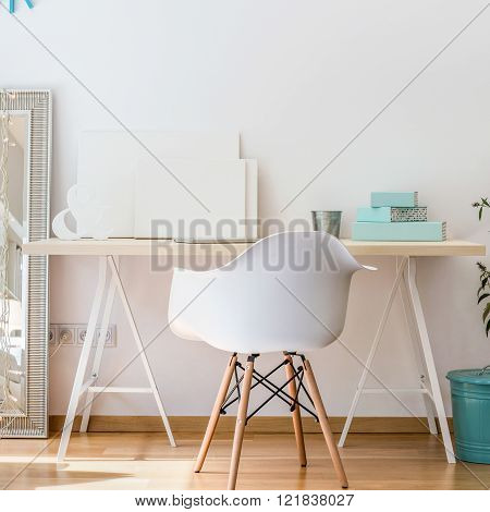 Photo of simple desk and white fashionable chair