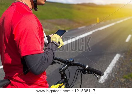 Happy biker using his phone in Iceland