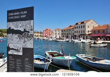 STARI GRAD CROATIA - JULY 17: Panorama of historical centre with a city map of Stari Grad on July 17 2012. Stari Grad is a town on the northern side of the island of Hvar in Dalmatia Croatia.