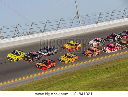 Daytona Beach, FL - Feb 21, 2016: Matt Kenseth (20) and Denny Hamlin (11) touch on the last lap of Daytona 500 at the Daytona International Speedway in Daytona Beach, FL.