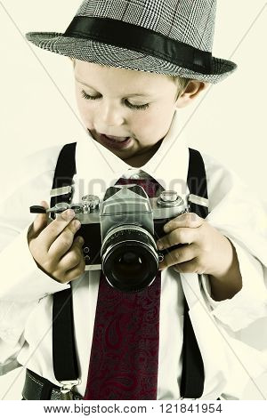 Young Boy Playing With An Old Camera To Be Photographer