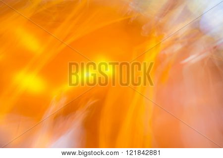 Orange color abstract background from long exposure and camera swing techinc