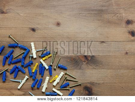 screws with blue and yellow dowels