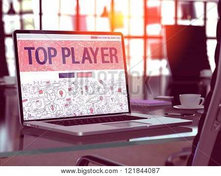Top Player on Laptop in Modern Workplace Background.