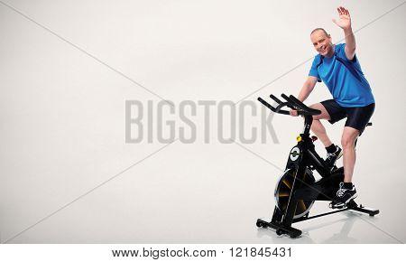 Senior Man cycling on bike trainer.