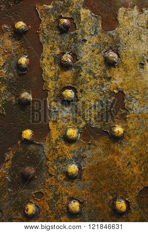Grunge Background Of Rusty Rivetted Metal