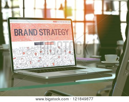Brand Strategy on Laptop in Modern Workplace Background.