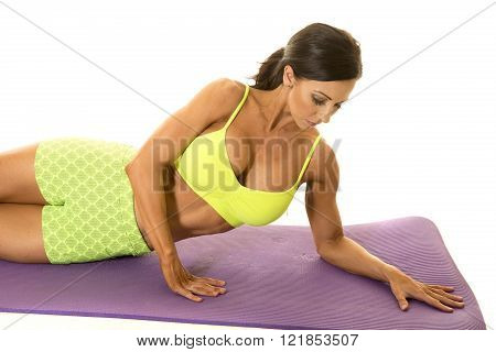 a woman laying on her side getting ready to work her obliques.