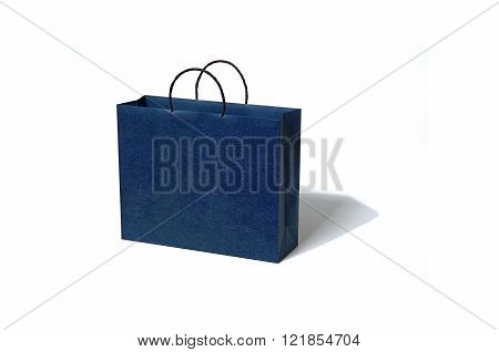 Blue paper bag on white background