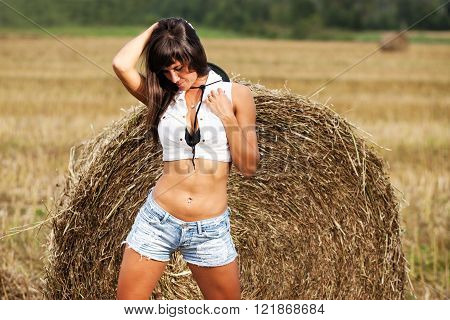 Girl in a jeans shorts on field