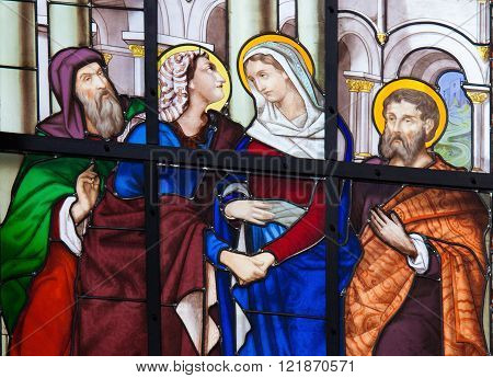 BRUSSELS, BELGIUM - JULY 26, 2012: Stained Glass window depicting the Visitation, Mother Mary's visit to her niece Elisabeth, in the Cathedral of Brussels, Belgium.