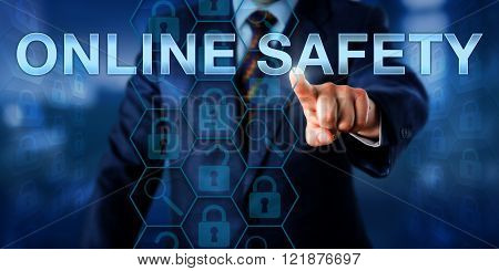 Network administrator is pressing ONLINE SAFETY on a touch screen interface. Information technology metaphor and security concept for personal safety of a corporate internet user accessing the web. poster