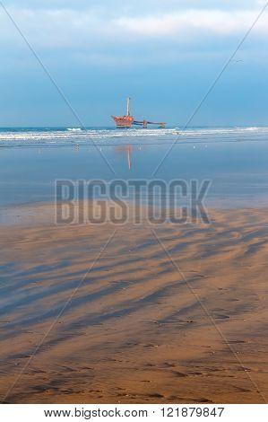 Seascape of Atlantic Ocean. Old ship in Morocco, El Jadida