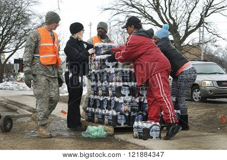 Flint, Michigan, USA - January 23, 2016:Distribution of clean bottled water to residents by the National Guard. Downtown Flint, Michigan