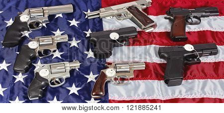 Pistols and revolver assorted firearms for sale on USA America flag