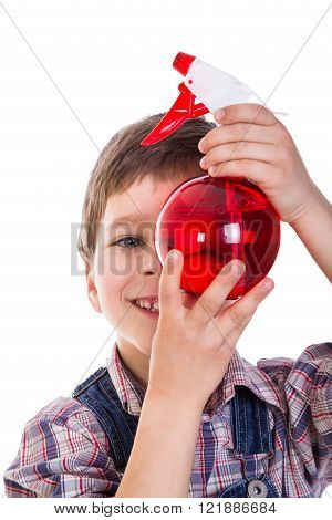 Boy with red sprayer in hands