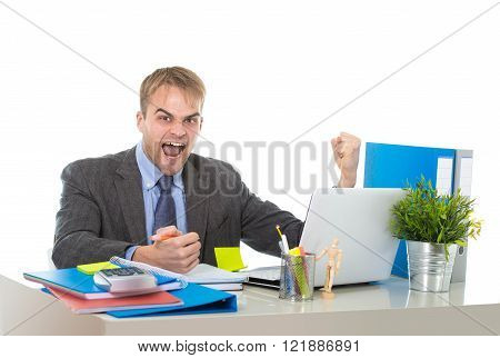 corporate portrait of young attractive businessman gesturing and celebrating business success excited raising his fist in victory and euphoria concept isolated on white background