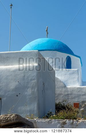 Amazing White chuch with blue roof in town of Parakia, Paros island, Cyclades, Greece
