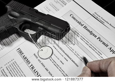 Man with gun and permit application documents