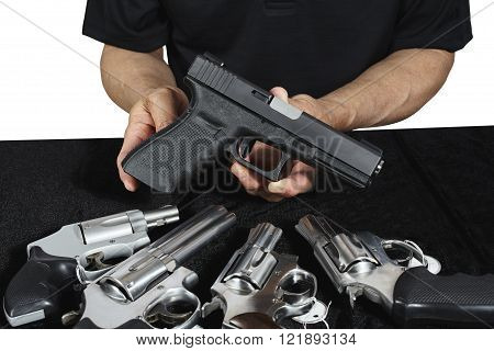 Man displaying pistol and revolver firearms for sale