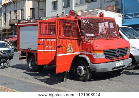 ATHENS GREECE - MAY 04: Greece Firefighters Truck in Athens on MAY 04 2015. Hellenic Fire Brigade and Rescue Service Vehicle in Central Athens Greece.