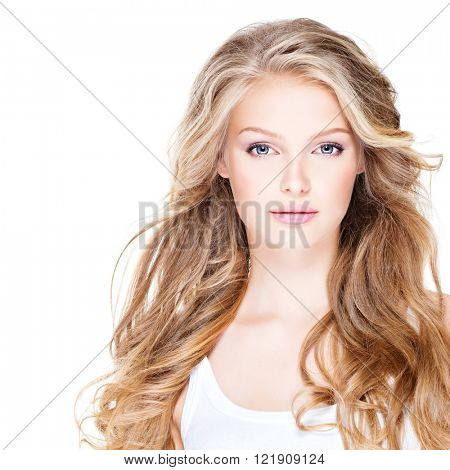Portrait of beautiful happy young woman with long curly hair - isolated on white.