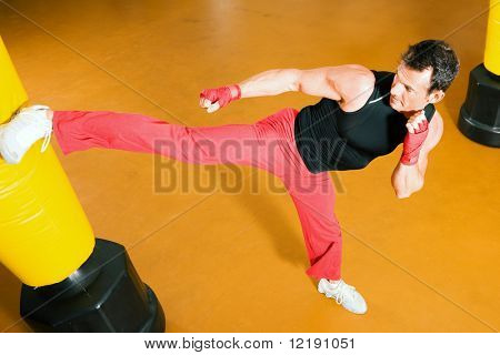 Kickboxer kicking the sandbag