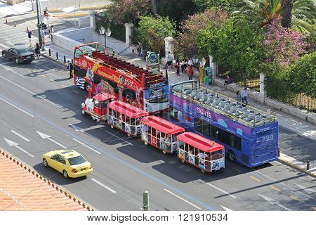 ATHENS GREECE - MAY 02: Open Tour Buses and Tourists Train in Athens on MAY 02 2015. Small Train and Tourist Coach Parked Near Syntagma Square in Athens Greece.