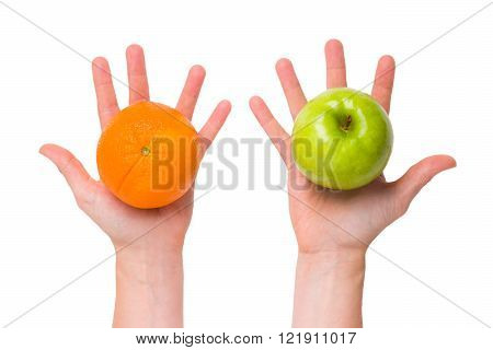 Compare apples with oranges (conceptual shot for differentiation and comparison)
