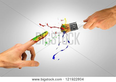 Creative hand with paintbrush creating new man on a grey background