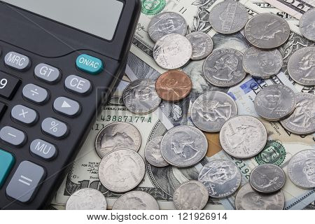 United States bank notes and coins with a calculator
