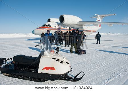Drifting ice floe is in the neutral waters of the Arctic Ocean - April 28 2011: The Russian aircraft AN-74P MOE on an ice runway near the polar station SP-38 drifting on an ice floe in the area of North Pole
