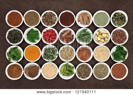 Health food and herb selection for men in white porcelain bowls over lokta paper background.